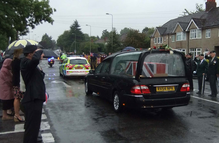 The coffin, draped in a Union Jack